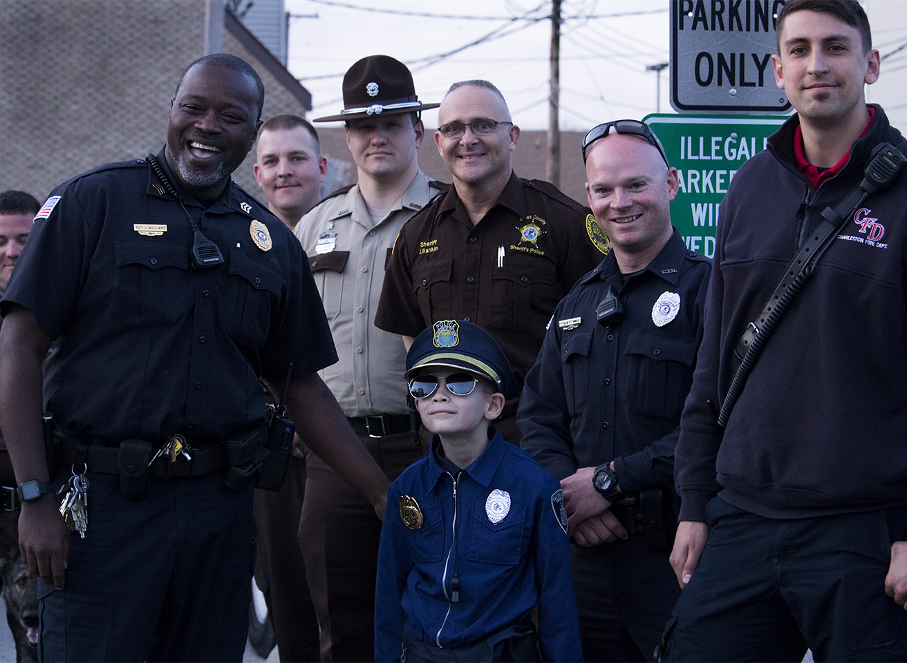 Tristan Farris (center), with police officers from multiple departments and the Charleston Fire Department. Sgt. Jimmy Williams (left) organized the whole event as a suprise for Tristan.