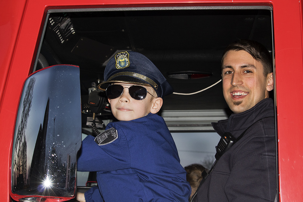 The Charleston Fire Department let Tristan Farris play in the fire engine, Tuesday night outside of the Doudna Fine Arts Center. Before this Tristan got to play in a police car and play with the sirens.