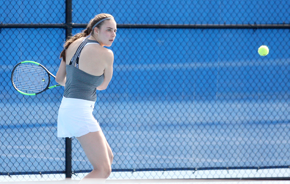 Sophomore Stella Cliffe returns the ball on her backhand in her doubles match Friday at the Darling Courts. Cliffe was named OVC Women's Tennis Player of the Week on Wednesday.