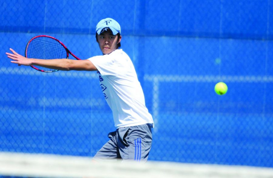 Freshman Kaisei Kuroki looks to hit a forehand over the net in his singles match March 30 at the Darling Courts against Belmont. Eastern starts the OVC Tournament Friday.