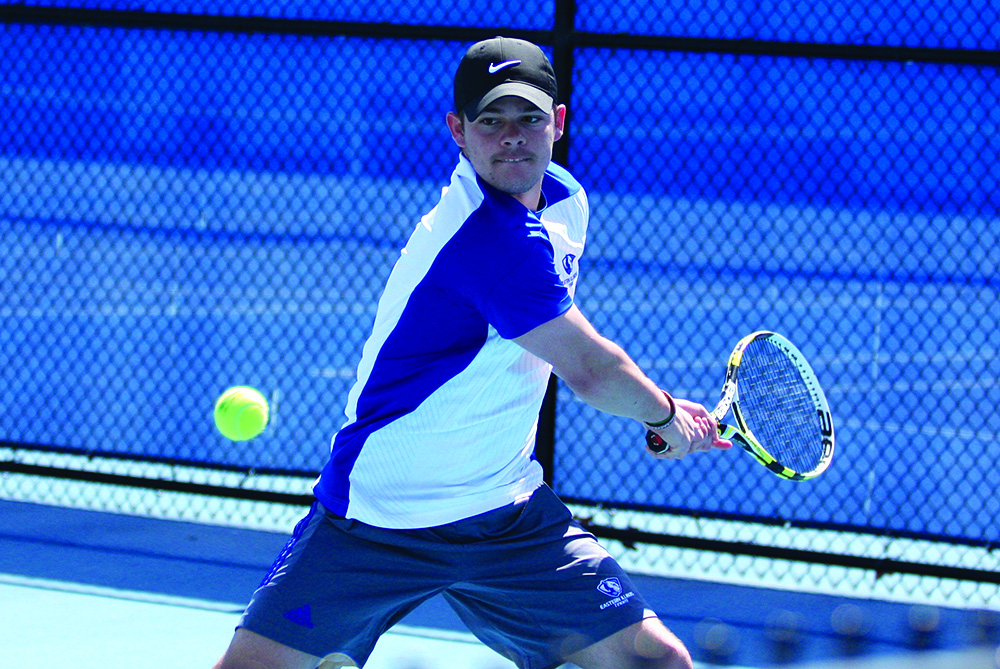 Senior Grant Reiman sends a back hander to his Belmont doubles opponents Friday at the Darling Courts. Reiman and partner Logan Charbonneau lost 7-5 to Belmont as Eastern lost 7-0 overall. The Panthers picked up a win Saturday against Tennessee State.