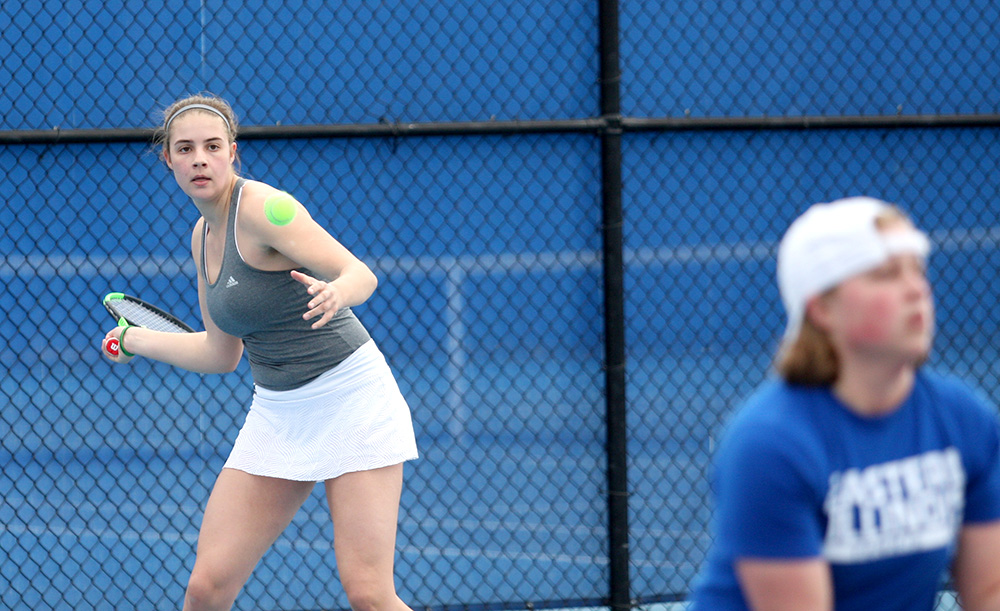 Sophomore Stella Cliffe returns the ball in her doubles match with partner Grace Summers against Belmont March 30 at the Darling Courts. The Panthers open the OVC Tournament this weekend.