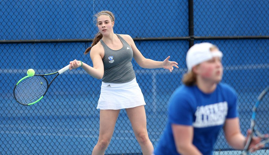 Sophomore+Stella+Cliffe+hits+a+forehand+in+her+doubles+match+with+partner+Grace+Summers.+Cliffe+and+Summers+won+6-4.+The+women%E2%80%99s+tennis+team+does+not+have+a+player+from+Illinois%2C+but+all+agree+the+different+backgrounds+have+helped+them+grow+together.
