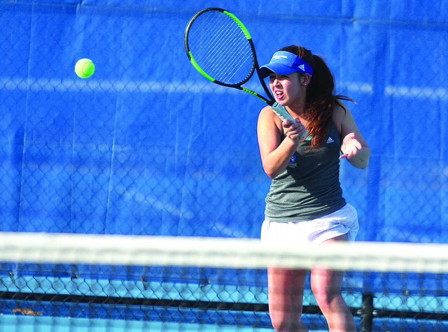 Sophomore Emily Pugachevsky hits a forehand back to her Belmont opponent in her singles match Friday at the Darling Courts. Pugachevsky won 6-4, 6-4 to help the Panthers to a 5-2 win over the Bruins.
