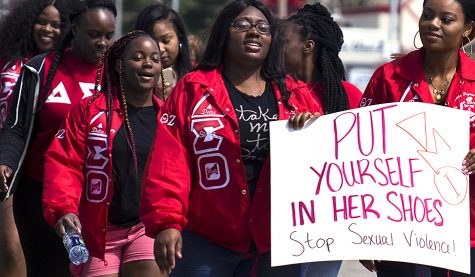 "Members of Delta Sigma Theta participate in ""Walk a Mile in Her Shoes,"" Sunday along Lincoln Avenue. The sorority won the ""Dream Team"" award for having the largest number of people in their group."