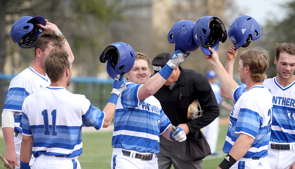 Junior Hunter Morris' celebrates his second-inning grand slam with Jimmy Huber (far left), Jimmy Govern (11) and Dougie Parks (right). Eastern beat Robert Morris 15-6 Wednesday at Coaches Stadium.
