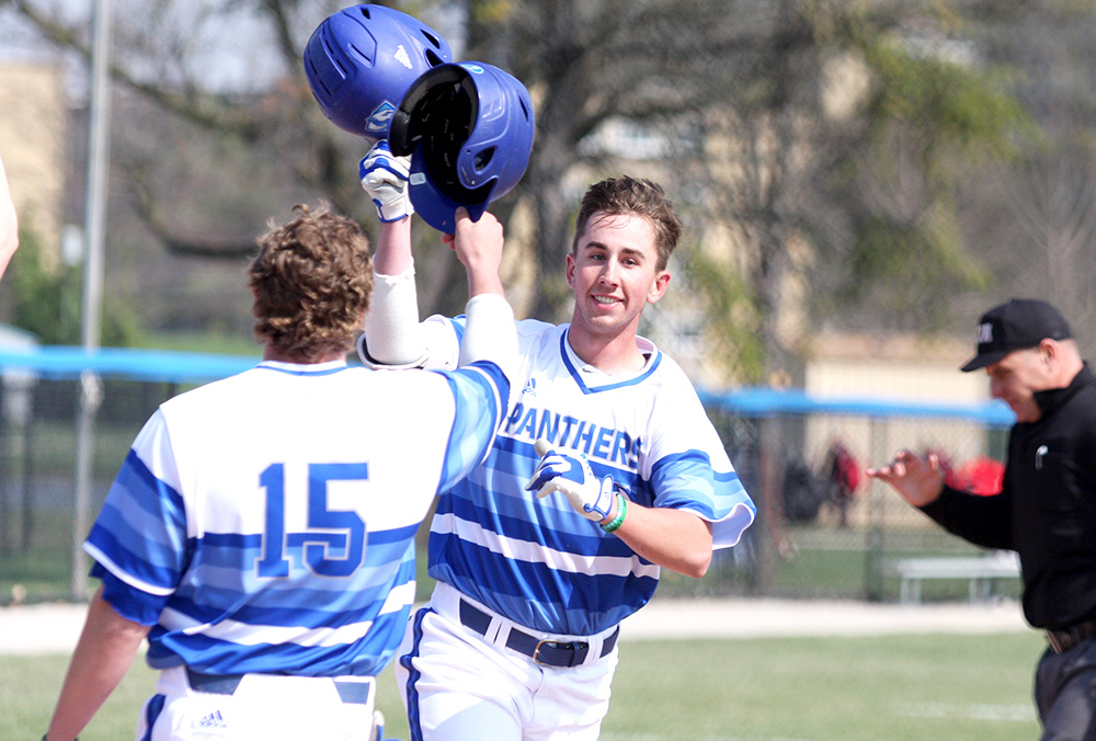 Junior Jimmy Huber celebrates his second home run of the first inning with redshirt junior Tyler Tesmond, who scored on Huber's two-run home run. The Panthers beat Illinois State 17-13 Wednesday at Coaches Stadium.