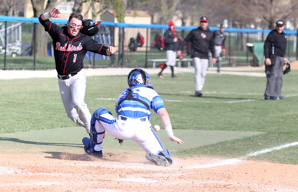 Illinois State sophomore Jordan Libman scoots around Eastern catcher Ryan Knernschield to score a run in Eastern's 17-13 win over the Redbirds April 18 at Coaches Stadium. The Panthers were swept by Eastern Kentucky over the weekend, but are back at home to host Saint Louis at Coaches Stadium.