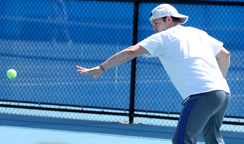 Senior Trent Reiman sends a forehand over the net in his singles match against Belmont March 30 at the Darling Courts. Eastern starts the OVC Tournament later this week.