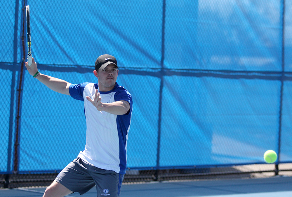 Senior Grant Reiman returns the ball on his forehand in Eastern's match against Belmont March 30 at the Darling Courts. Despite a first-round OVC Tournament loss, Eastern improved overall and has the team excited for the future.