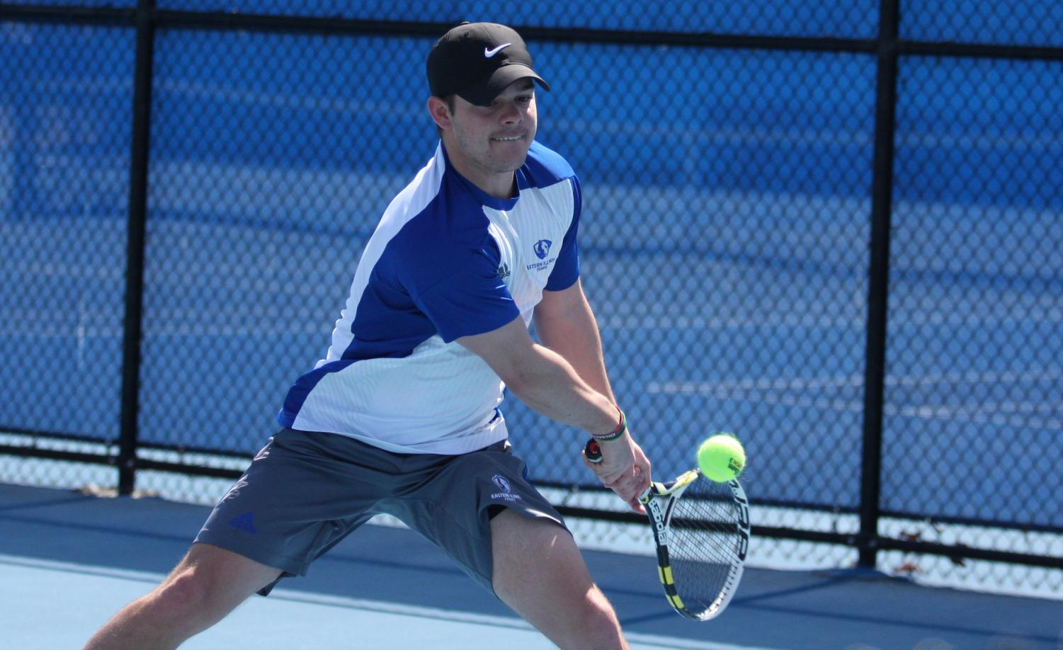 Eastern senior Grant Reiman returns a ball in the Panthers' meet last Friday at the Darling Courts. Reiman and his partner lost in the No. 3 doubles position.