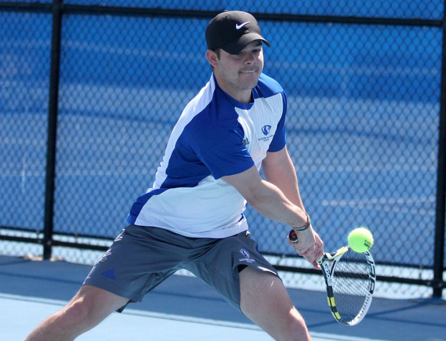 Senior+Grant+Reiman+returns+a+backhand+in+his+match+against+Belmont+March+30+at+the+Darling+Courts.+Eastern+won+its+Senior+Day+match+against+Marian+Saturday.