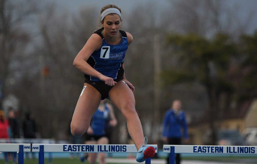 Eastern freshman Morgan Atchison runs the 400-meter hurdles at the EIU Big Blue Classic at O'Brien Field on March 30. Atchison finished in 12th place in a time of 1 minute 8.36 seconds.