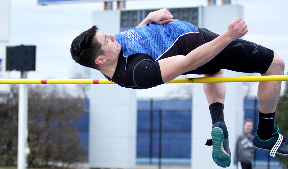 Junior Ashton Wilson jumps over the bar in the men's high jump at the EIU Big Blue Meet March 31 at O'Brien Field. WIlson finished tied for second after jumping 6-feet-.75 inches in the men's high jump at the Illinois Twilight meet over the weekend.