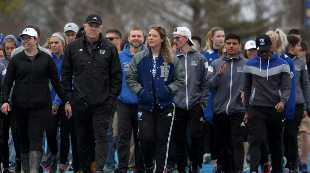 Eastern track and field coach Tom Akers leads the honorary walk around the track for his last home meet as coach Friday at O'Brien Field. The women's track team placed third and the men's team finished second in the EIU Big Blue Classic.