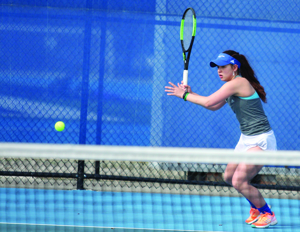 Eastern sophomore Emily Pugachevsky returns a ball in Eastern meet at the Darling Courts on March 30. The Panthers won the meet 5-2 against Belmont.