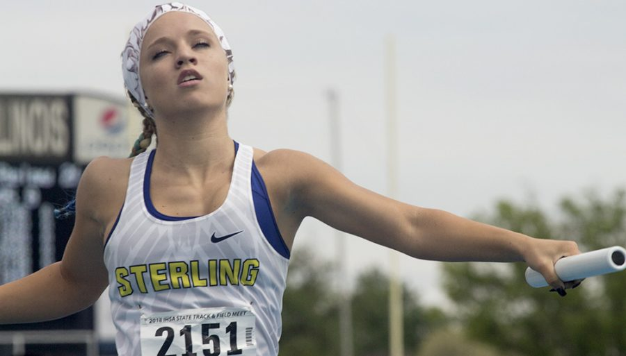Erin Long, a senior at Sterling High School, competes in the 2A, 4x200 meter relay with her team at the Illinois High School Association Girl's State Track & Field competition at O'Brien Stadium, at Eastern. Long and her teammates received fourth in the event.