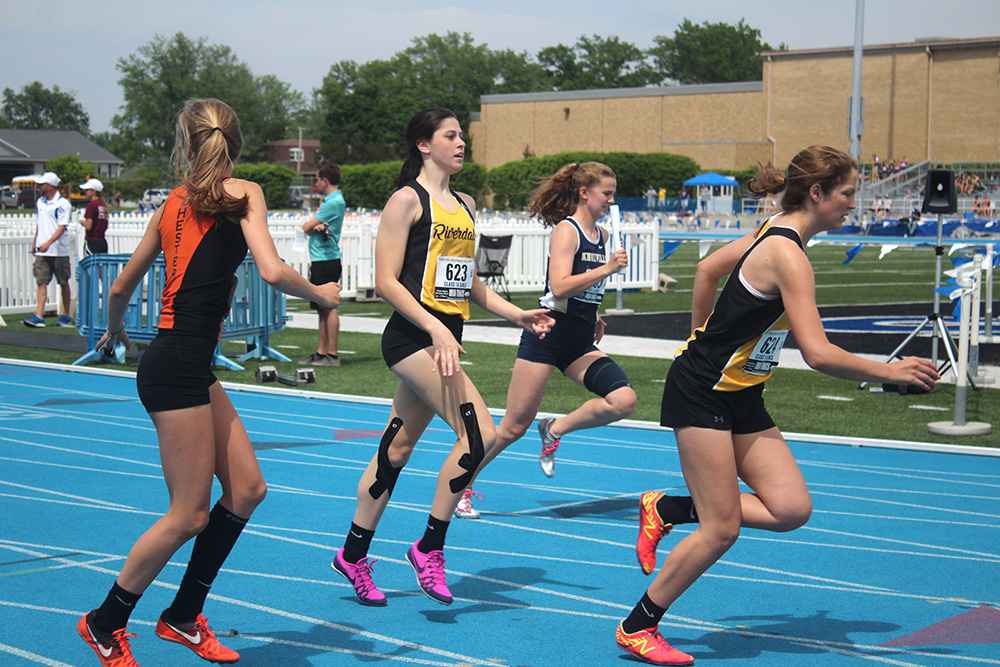 Students race to the finish line at the Illinois High School Association Girl's Track & Field meet, Thursday afternoon at O'Brien Stadium.