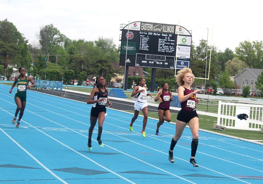 Participants race down the track during the 100-meter dash Thursday.