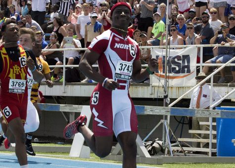 Marcellus Moore, a sophomore from Plainfield North High School, smiles and gives a thumbs up after crossing the finish line in first place Saturday during the 100-meter dash at the Illinois High School Association Boys Track and Field state finals at O'Brien Field.