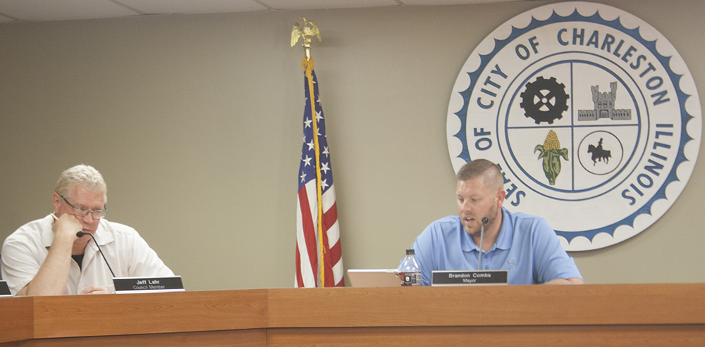 Councilman Jeff Lahr, and Mayor Brandon Combs, go over street closure requests for the Fourth of July festivities, Tuesday night at the City Council meeting. Combs and the rest of the council agreed to the street closures for the parade and other festivities.