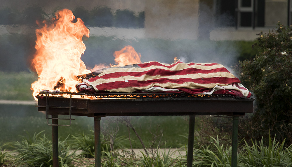 The+worn+American+flag+burns+until+the+only+thing+left+of+it+is+ashes%2C+during+the+flag+disposal+ceremony%2C+Tuesday+evening+in+the+south+quad.