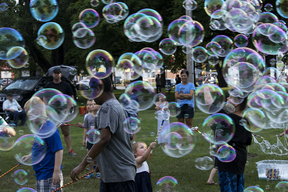 Children+play+with+bubbles+while+their+family+members+watch+from+the+side%2C+Tuesday+afternoon+at+Red+White+and+Blue+Days+in+Morton+Park.