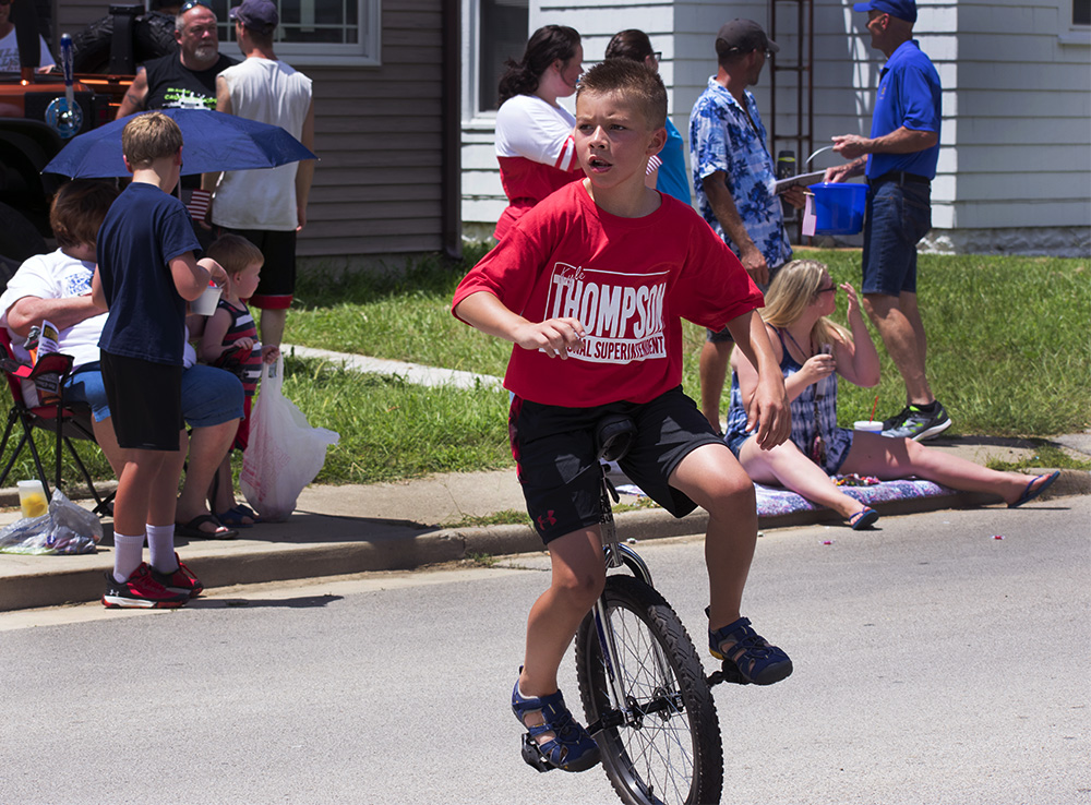 A+boy+rides+a+unicycle+down+Division+Street+Wednesday+afternoon+at+the+Fourth+of+July+Parade.
