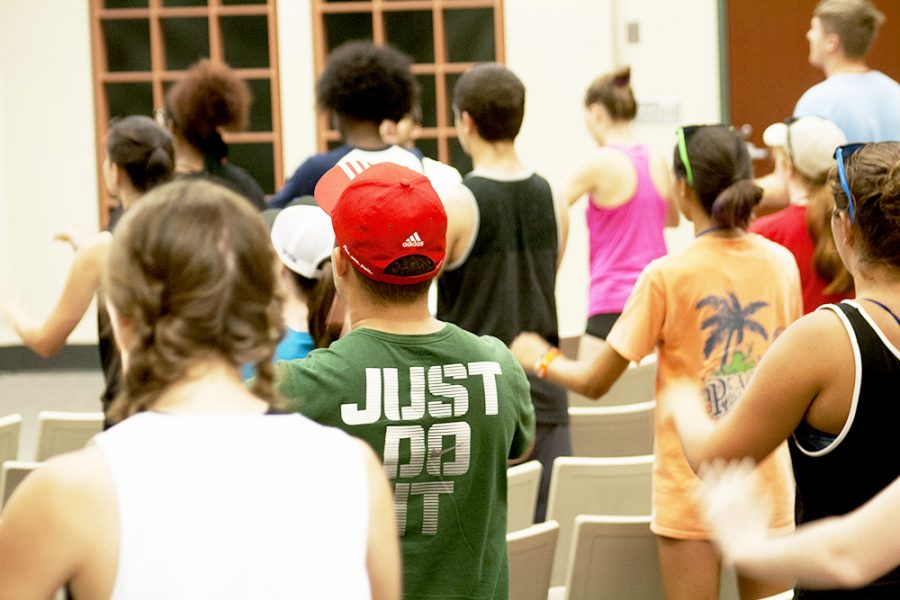 The Smith Walbridge Drum Major Clinic's camp members learning and practicing difficult music cadences during their camp Tuesday afternoon in the Buzzard Hall Auditorium. They were going through the motions along to music as their instructor coached and encouraged them.