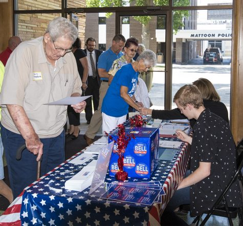 Locals sign in and make donations to support Shirley Bell's campaign for state representative of the 110th District Tuesday afternoon at Burgess-Osborne Auditorium.