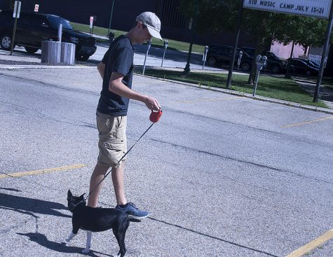 Sam White walks with his dog by the Martin Luther King Jr. University Union.