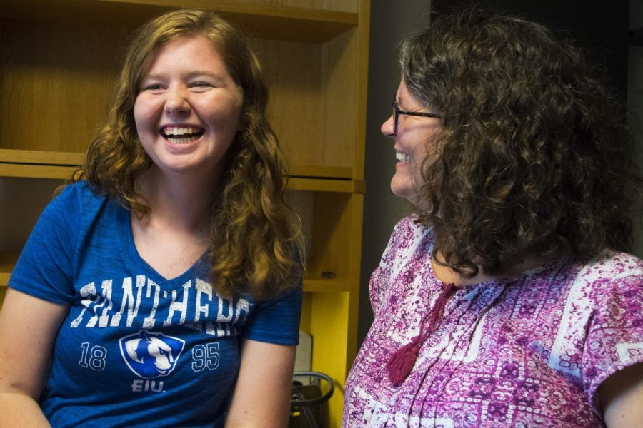 Rachel and Lisa Mette, daughter and mother, talk in Rachel's new, undecorated dorm room in Andrew's Hall. Rachel was one of many freshman and transfer students who moved into Eastern on Thursday.