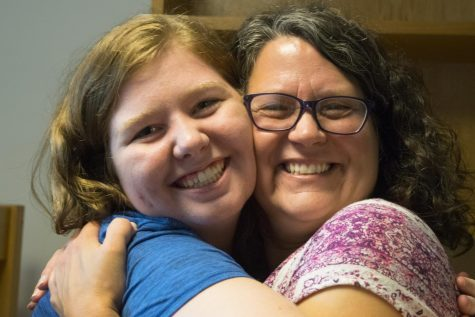 Brooke Schwartz | The Daily Eastern News Rachel Mette, an incoming freshman graphic design major from Effingham, Illinois, embraces her mother Lisa Mette in her new dorm room Thursday. Many freshman and transfer students, like Rachel, started Prowl weekend with a teary goodbye from their family.