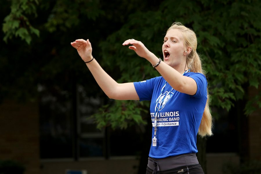 Robyn Heitman, one of the drum majors for for the Panther Marching Band leads the band in a performance on move in day Aug. 16 outside of Andrews Hall.