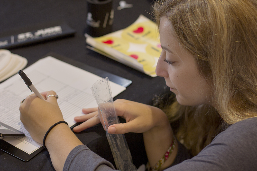 Rachel Winslow, a sophomore elementary education major, signs her name to indicate interest in participating in Up 'Til Dawn, a fundraiser for St. Jude's Children Research Hospital, at Pantherpalooza on Wednesday.