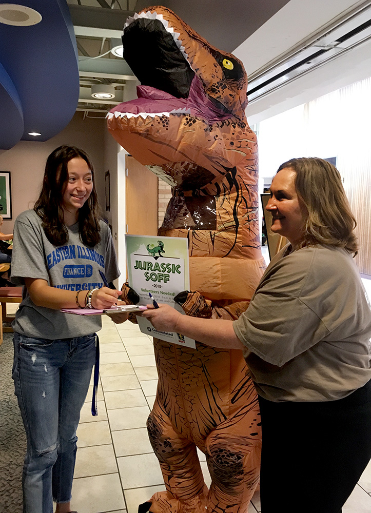 "Kayla Jandek, a freshman finance major, speaks to Laura Diltz and Elizabeth Stark about the special olympics event JURASSIC SOFF at Lakeland College on Saturday, September 15. ""We cannot do this event without Eastern Illinois University volunteers,"" Diltz said."