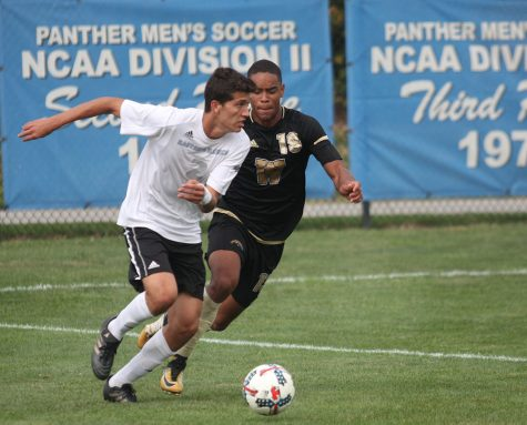 File Photo | The Daily Eastern News Eastern's Edgar Mesa pursues a ball in a game last season at Lakeside Field against Western Michigan. Mesa was named one of two Eastern players to watch in the Summit League.