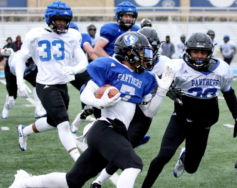 Senior wide receiver Aaron Gooch runs with the ball during Eastern's spring football game last year. Gooch is slotted to play receiver this season as well as handle return duties.