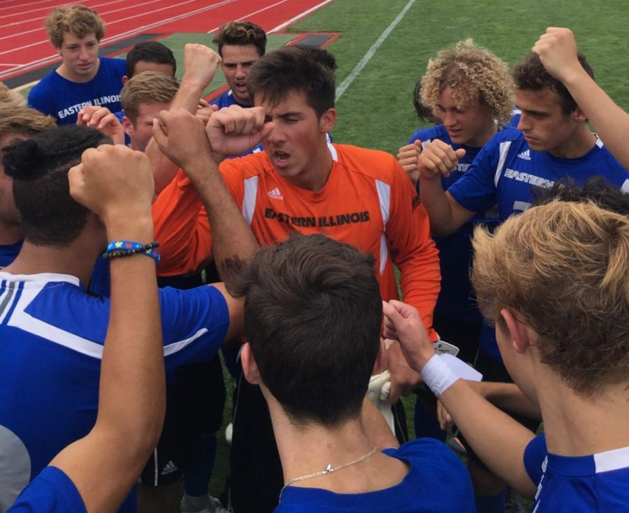 Redshirt-sophomore+goalkeeper+Jonathan+Burke+leads+the+men%E2%80%99s+soccer+team+in+a+huddle+during+Eastern%E2%80%99s+exhibition+match+aganst+Wisconsin+on+Aug.+14.