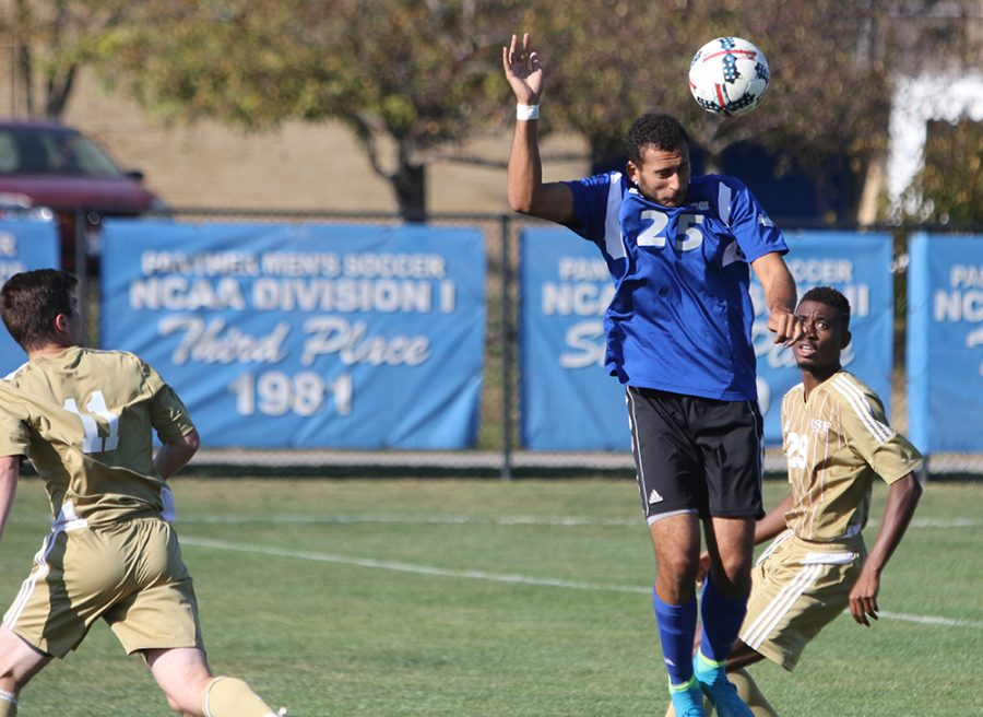 Sophomore forward Shady Omar wins a head ball against two St. Francis attackers in a September 2017 match at Lakeside Field.