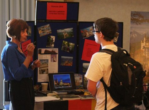 Christiane Eydt-Beebe, foreign languages department chair, talks with Eastern student Paul Blanchard about study abroad opportunities at the Study Abroad Fair on Sept. 5.