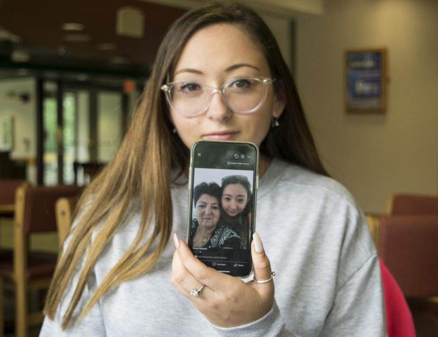 "Sonia Badash, a freshman mathematics and computer sciences major, holds a picture of her and her grandmother Galina Badash. Sonia Badash said her grandmother is one of the kindest people she knows. ""She's like a really sweet lady, and of course like she loves cooking like any other grandma,"" she said. ""That's just the kind of person she is, she loves everyone and is so caring and sweet."""