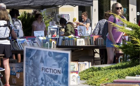 People look through books Wednesday during the annual Booth Library Fall Book Sale right by the clock tower.
