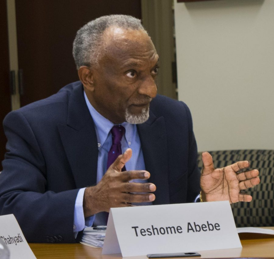Teshome+Abebe%2C+a+member+of+the+Faculty+Senate+and+economics+professor%2C+at+the+Faculty+Senate+meeting+Tuesday+in+Booth+Library.+The+senate+discussed+shared+governance+and+possible+ways+to+boost+communications+between+organizations+on+campus.+