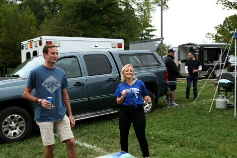 Conor Kilmartin, and Jennifer O'Bolye, a senior interpersonal communications major, play bean bags at the tailgate Saturday afternoon.