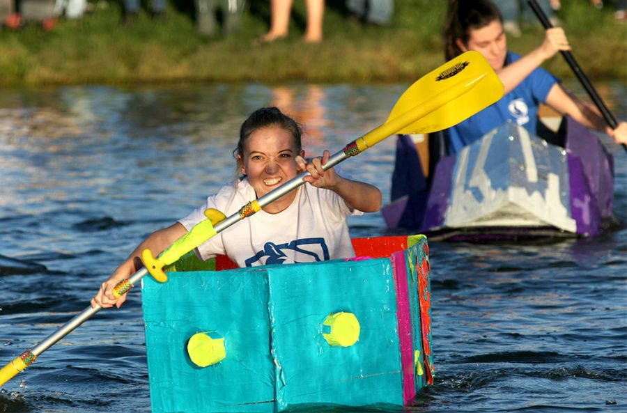 A student from McKinney Hall, competes in the ROC Fest Boat Race Thursday evening at the Campus Pond. McKinney Hall came in third place.