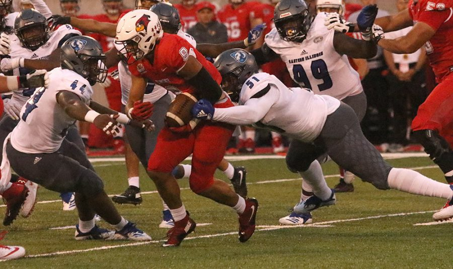 Eastern linebacker Dytarious Johnson (51) and defensive end Josh Price (44) tackle Illinois State running back Jordan Birch in a 48-10 loss on Sept. 8. The defense for Eastern has struggled this season to the point where an enitre system overhaul may happen.