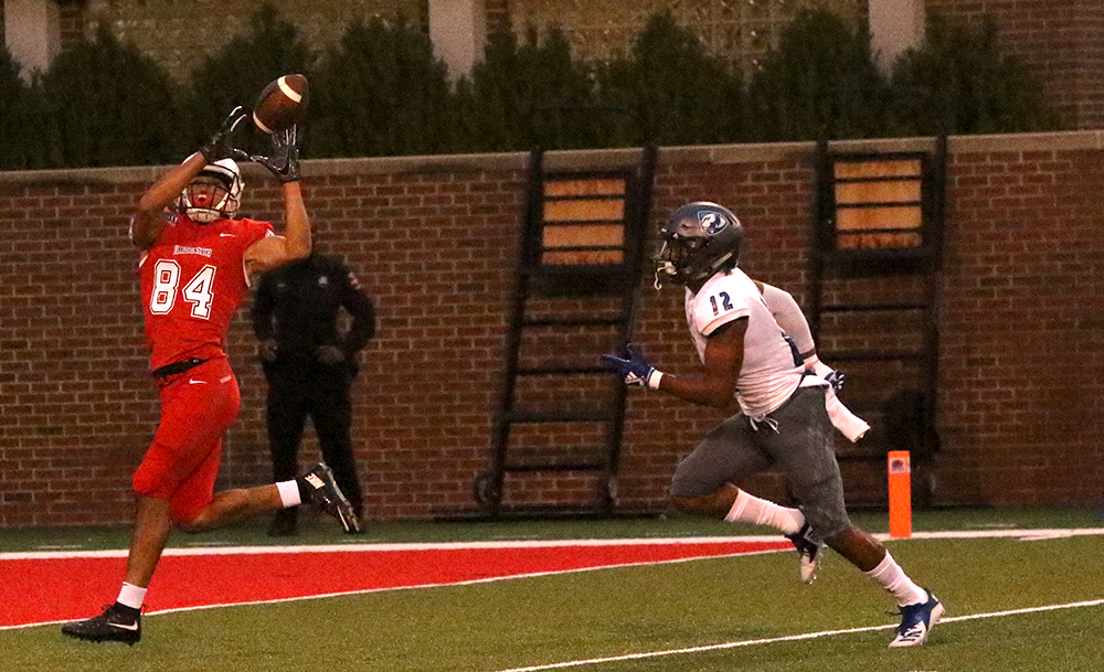 Illinois State receiver Andrew Edgar catches a touchdown pass as Eastern cornerback DySaun Smith trails behind. The Panther secondary gave up too many big plays in the team's eyes in a 48-10 loss to the Redbirds.