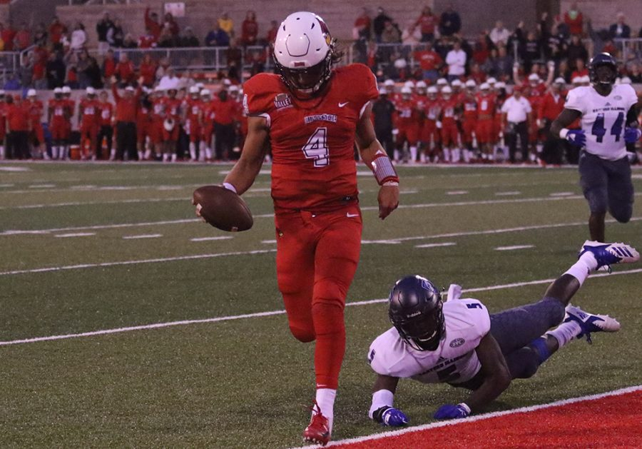 Illinois State quarterback Brady Davis crosses the goalline in a 48-10 blowout win over Eastern on Saturday. Davis had four touchdown passes as he helped the Redbirds drop Eastern to 0-2 on the season.