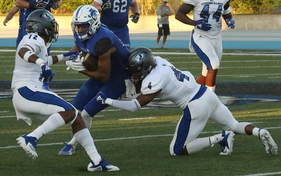Eastern safety Raymond Crittenden (4) and cornerback DySaun Smith (12) combine to make a tackle in a 51-44 loss to Indiana State on Saturday at O'Brien Field. Crittenden had a game-high 11 tackles, but the team as a whole struggled to make tackles all game.